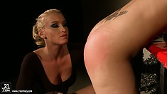On her knees, the stacked babe has the sexy blonde spanking her big ass