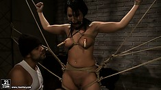 Slave bound and immobilize gets toyed with by her sadistic master