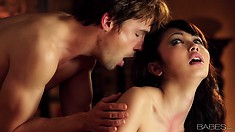Sweet Asian couzie in stockings lies in bed with young and horny guy