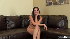 Perky little brunette Allie Haze sits on the couch in a live interview