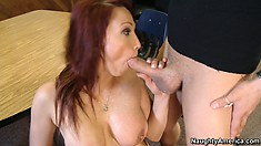 Nicki Hunter is spreading her ass open while getting fucked from behind