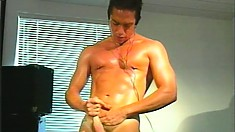 Hunky stud Marc Sabre enjoys his favorites tunes and jerks his cock to orgasm