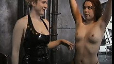 Skinny redhead gets her tits punished in a dungeon by her mistress