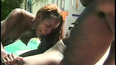 Redheaded ebony whore eats his dark meat poolside and gets pounded