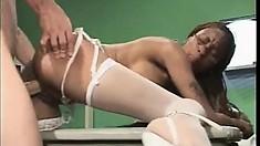 Long-legged ebony nurse fucks a horny guy on the hospital bed