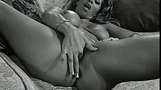 Two ravishing housewives share a big dildo and a hard cock on the sofa