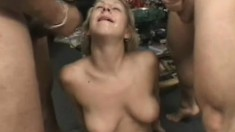 Blonde hottie with big natural tits entertains two long dicks at once