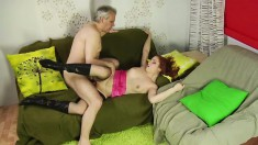 Redhead teen Nataliya tongues a horny old man's ass and fucks his cock