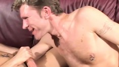 Young cocksuckers fuck hard on the couch before cumming together